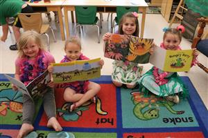 Pre K students reading books
