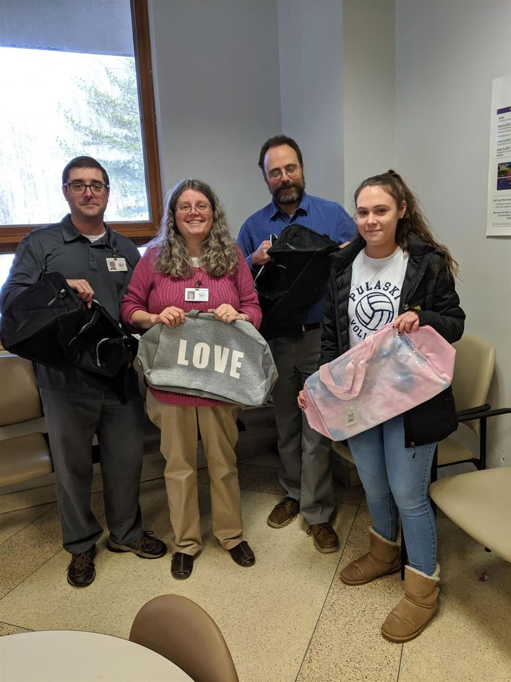 Cara Reynolds donates nearly 50 duffel bags to Oswego County Department of Social Services