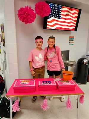 two students in pink